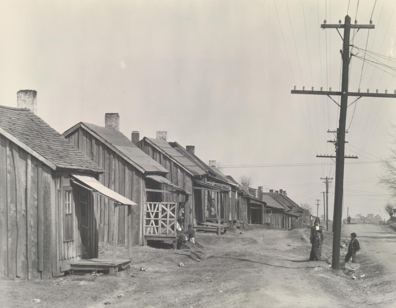 Houses and street in the Negro quarter, Tupelo, Mississippi