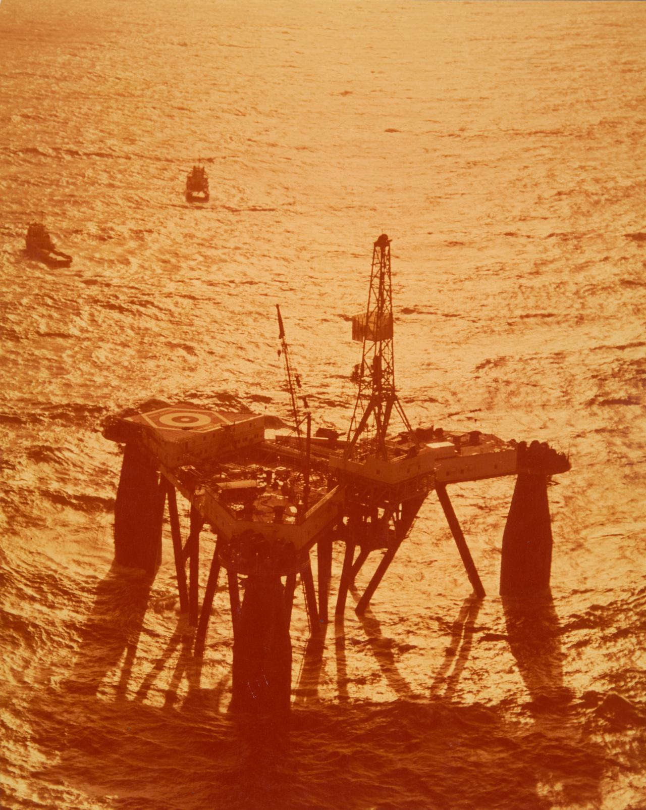 No title (Oil rig at sunset)