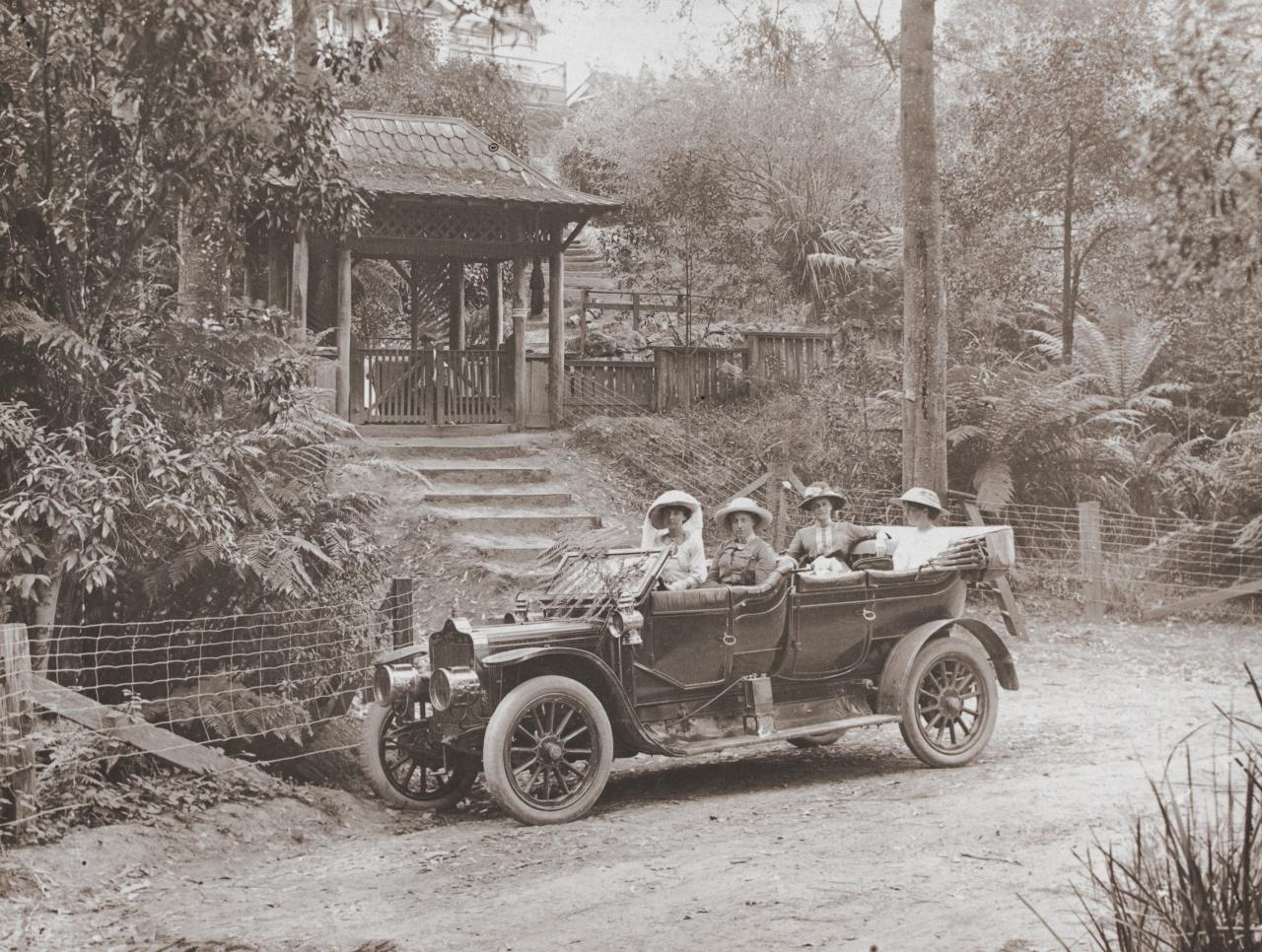 No title (Four women in open tourer car outside the hermitage gateway)