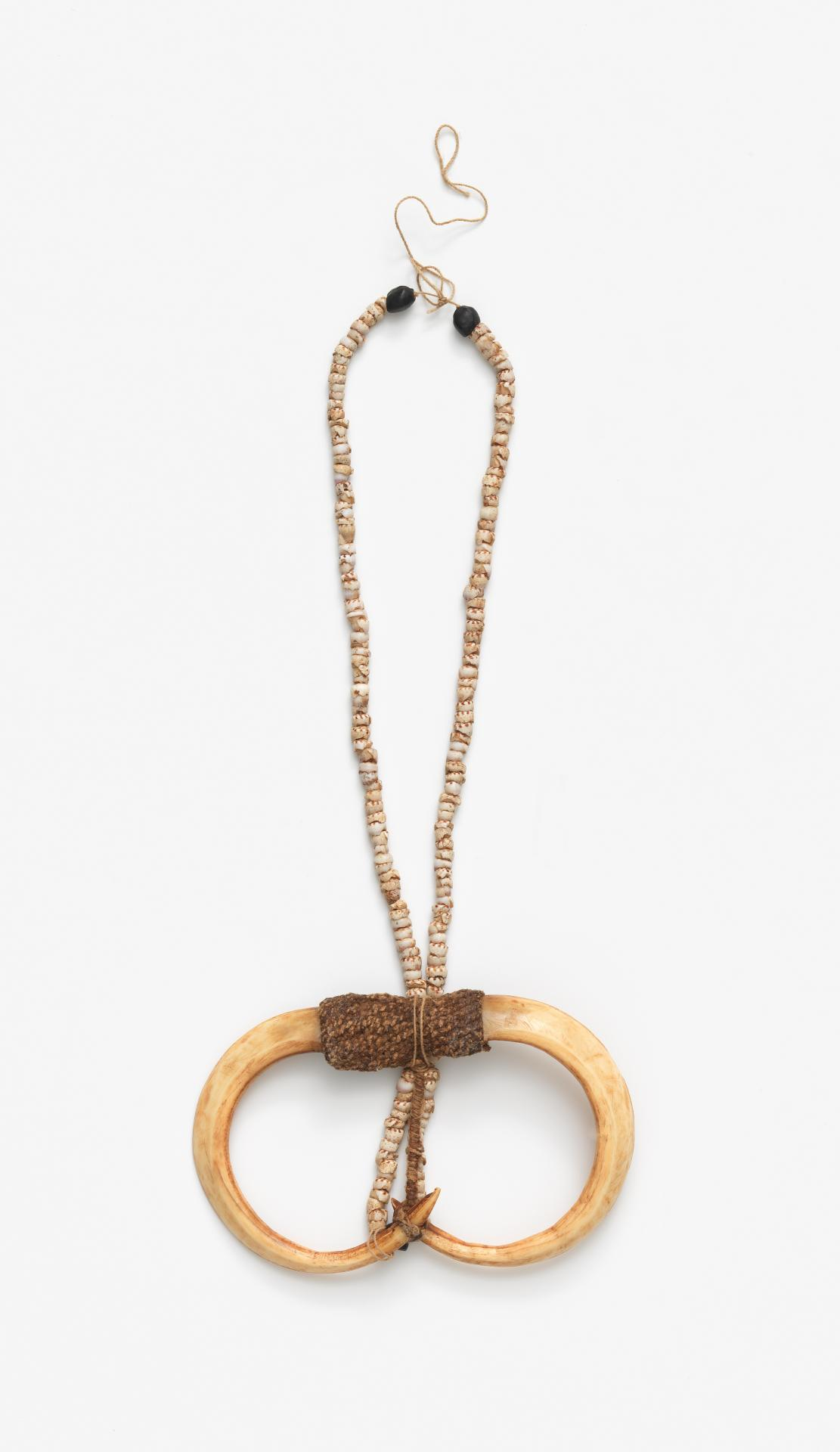 Double pig tusk necklace