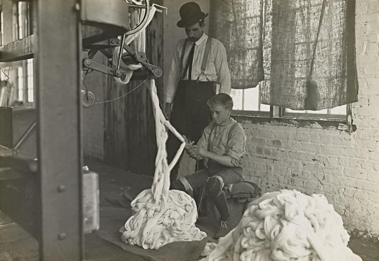Boy at a warping machine, Catawba Cotton Mill, Newton, North Carolina
