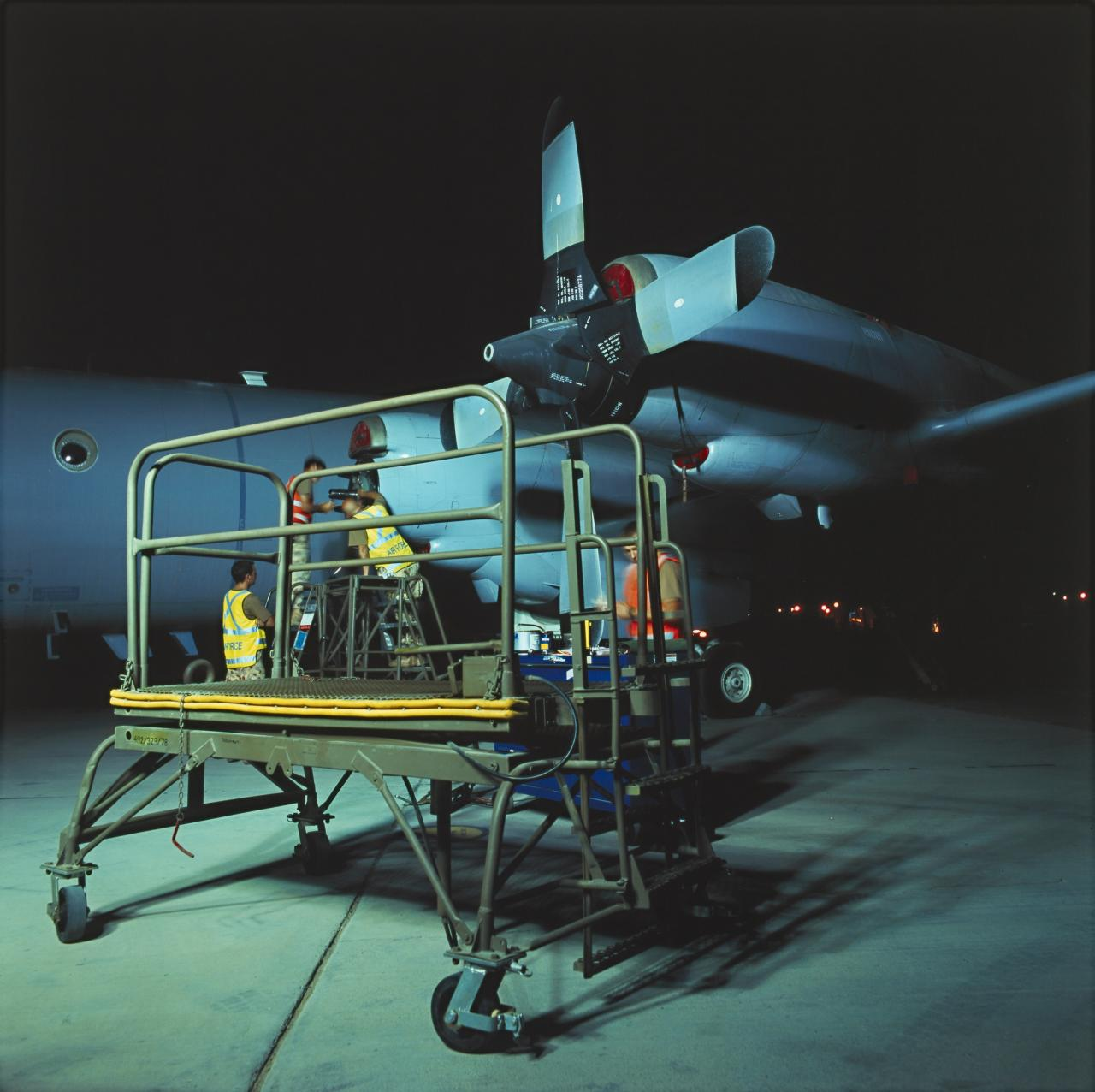 Trolley, propeller change, on flightline at night, military installation, Gulf