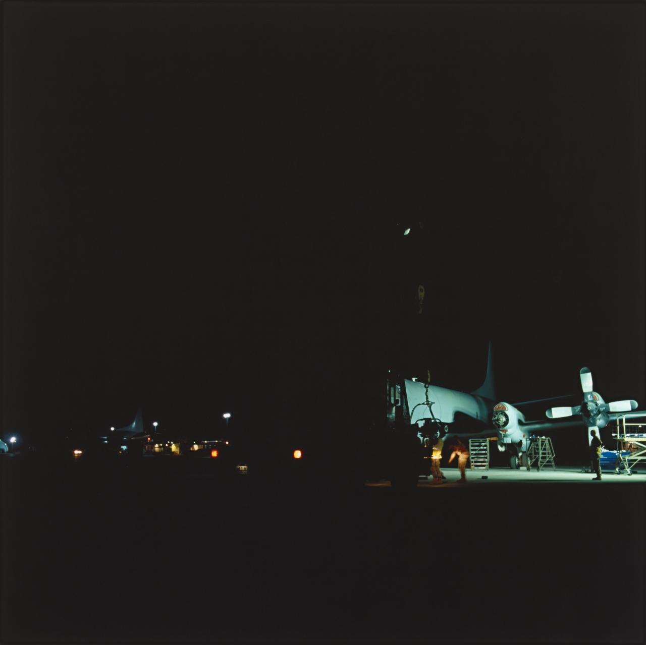 Night with two aircraft on flightline, military installation, Gulf