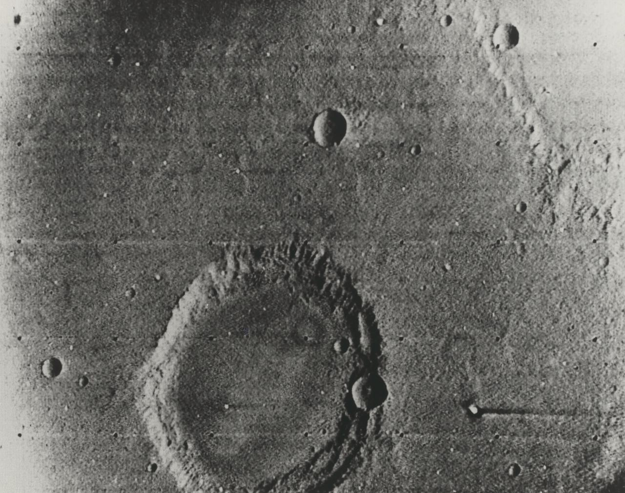 Mariner 6 picture of Mars. 63 x 48 miles featuring large crater about 24 miles across