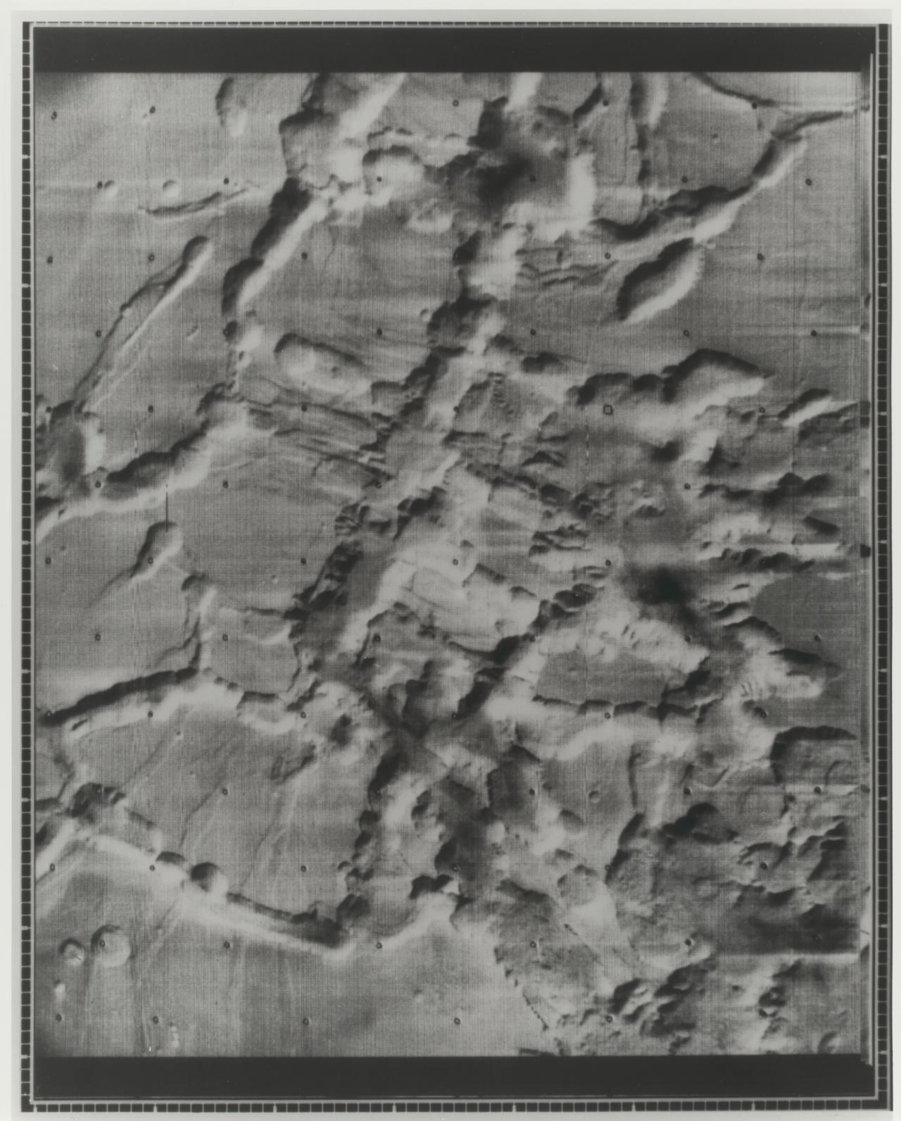 Mars. Mariner 9 photo of web of valleys near Nix Olympic Volcano, June 1972