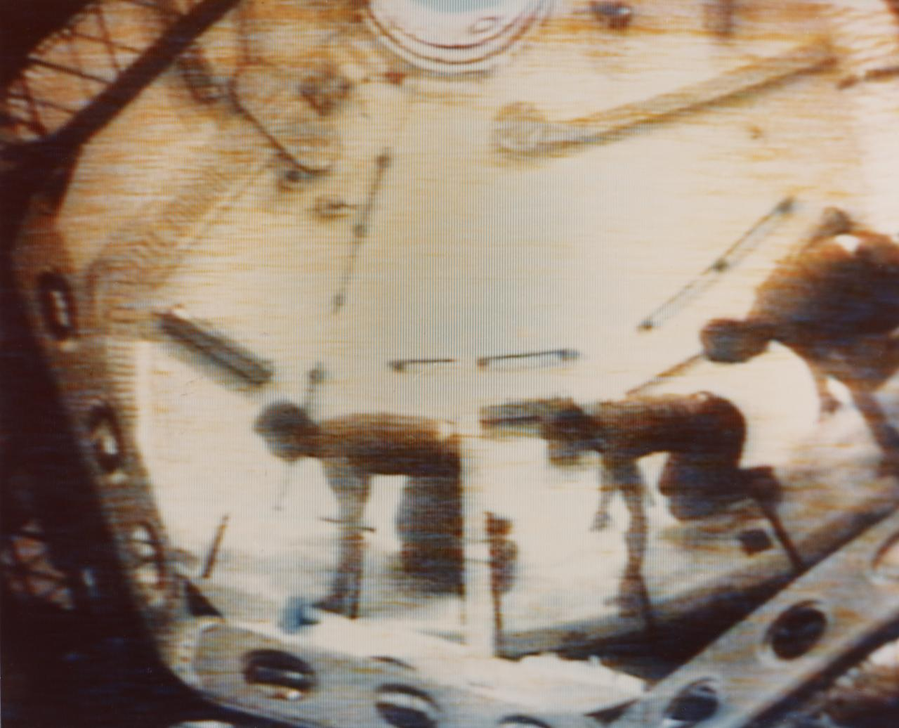 Three Skylab 2 crewmen demonstrate effects of weightlessness