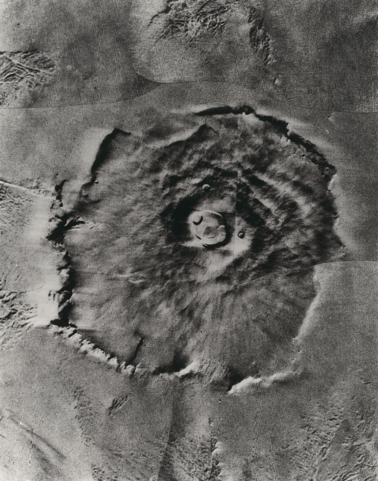 Mars. Nix Olympica; a gigantic volcanic mountain photographed by Mariner 9 in late January
