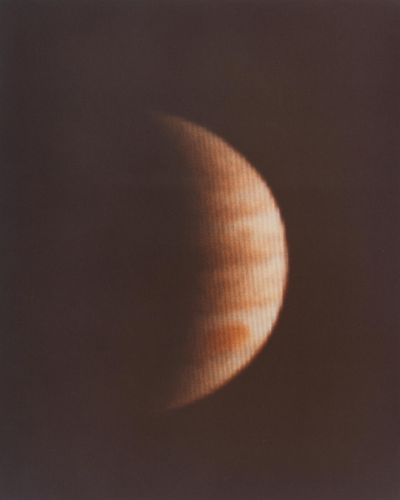 Crescent Jupiter with great red spot - Pioneer 10
