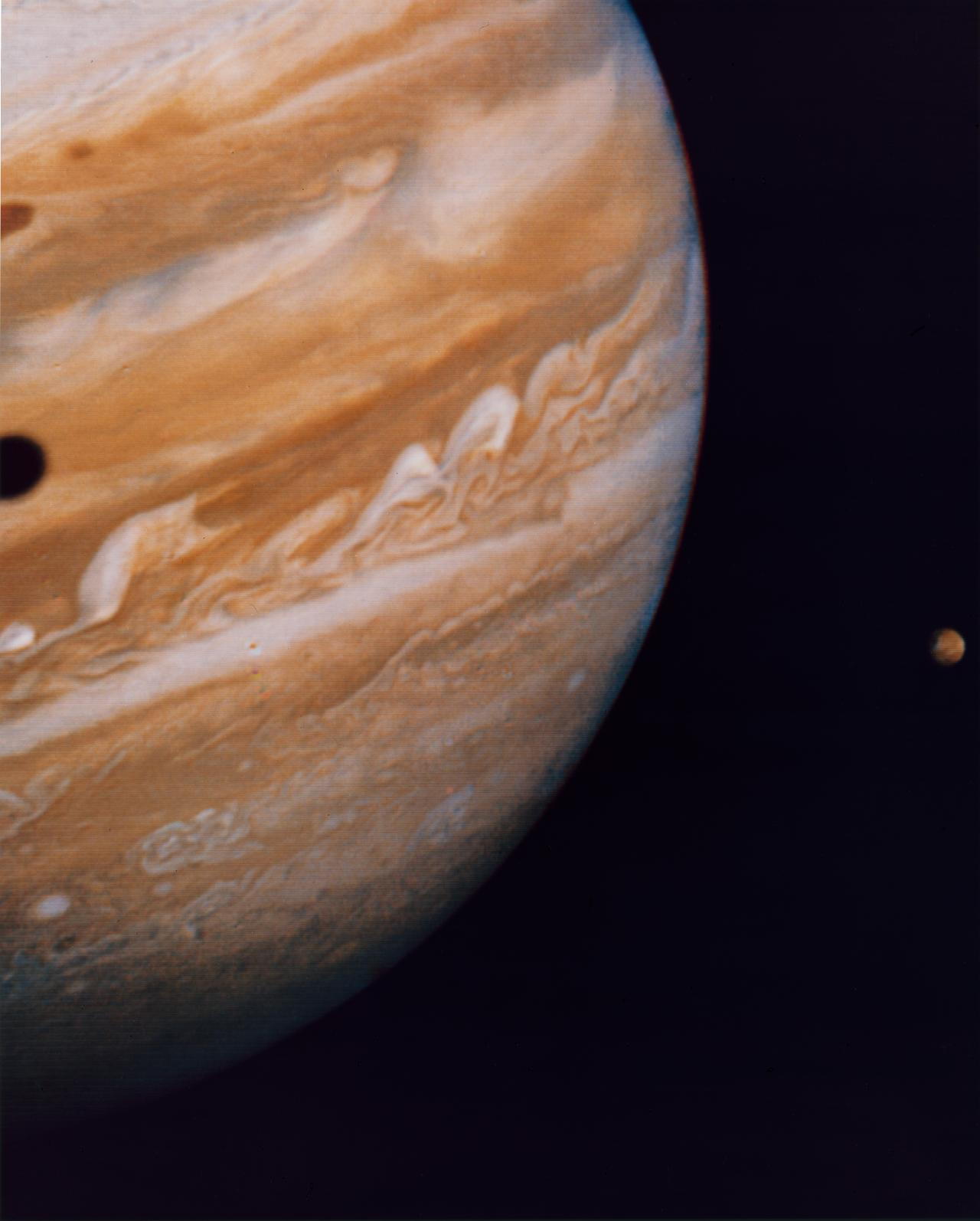 Jupiter, by Voyager 2 on 10 June 1979, with its moon Io and Ganymede's shadow
