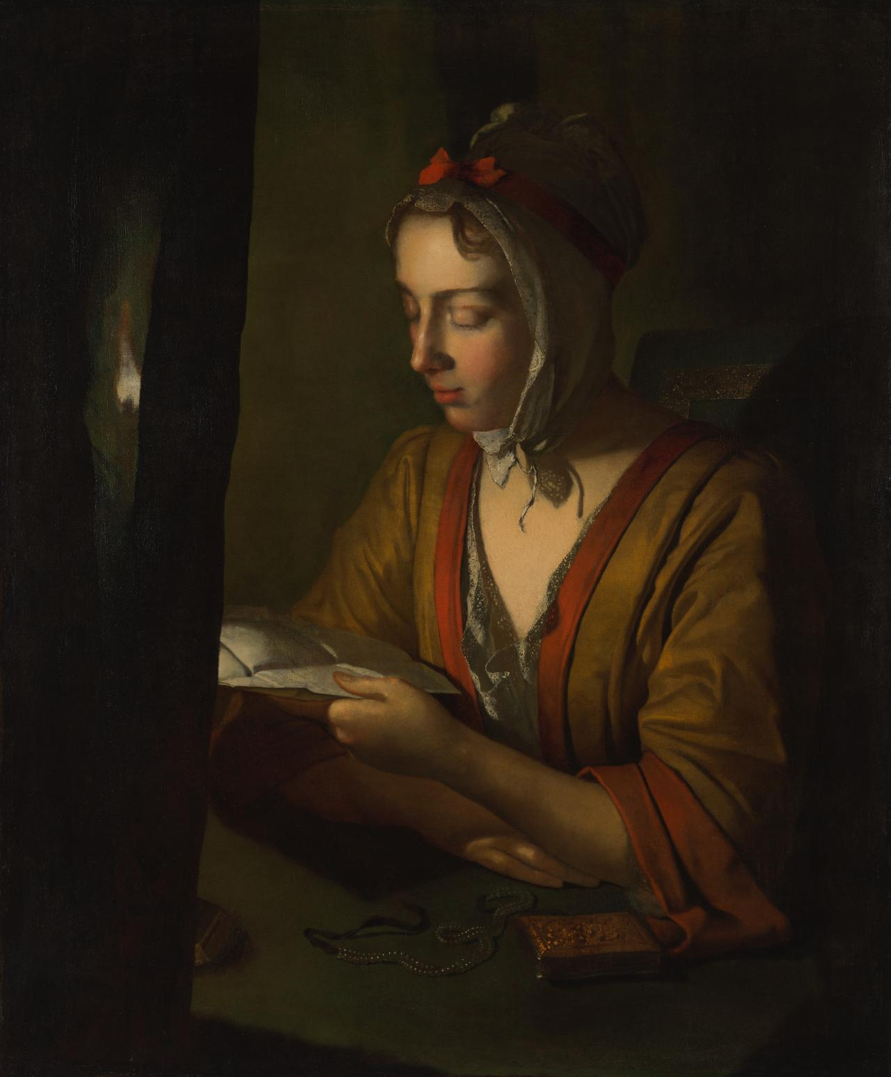 (Anna Romana Wright reading by candlelight)