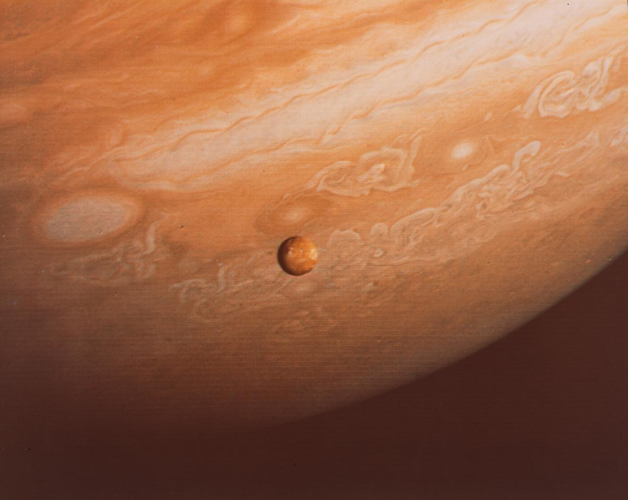 Voyager 2 photo of southern hemisphere of Jupiter showing its moon Io, on 25 June 1979