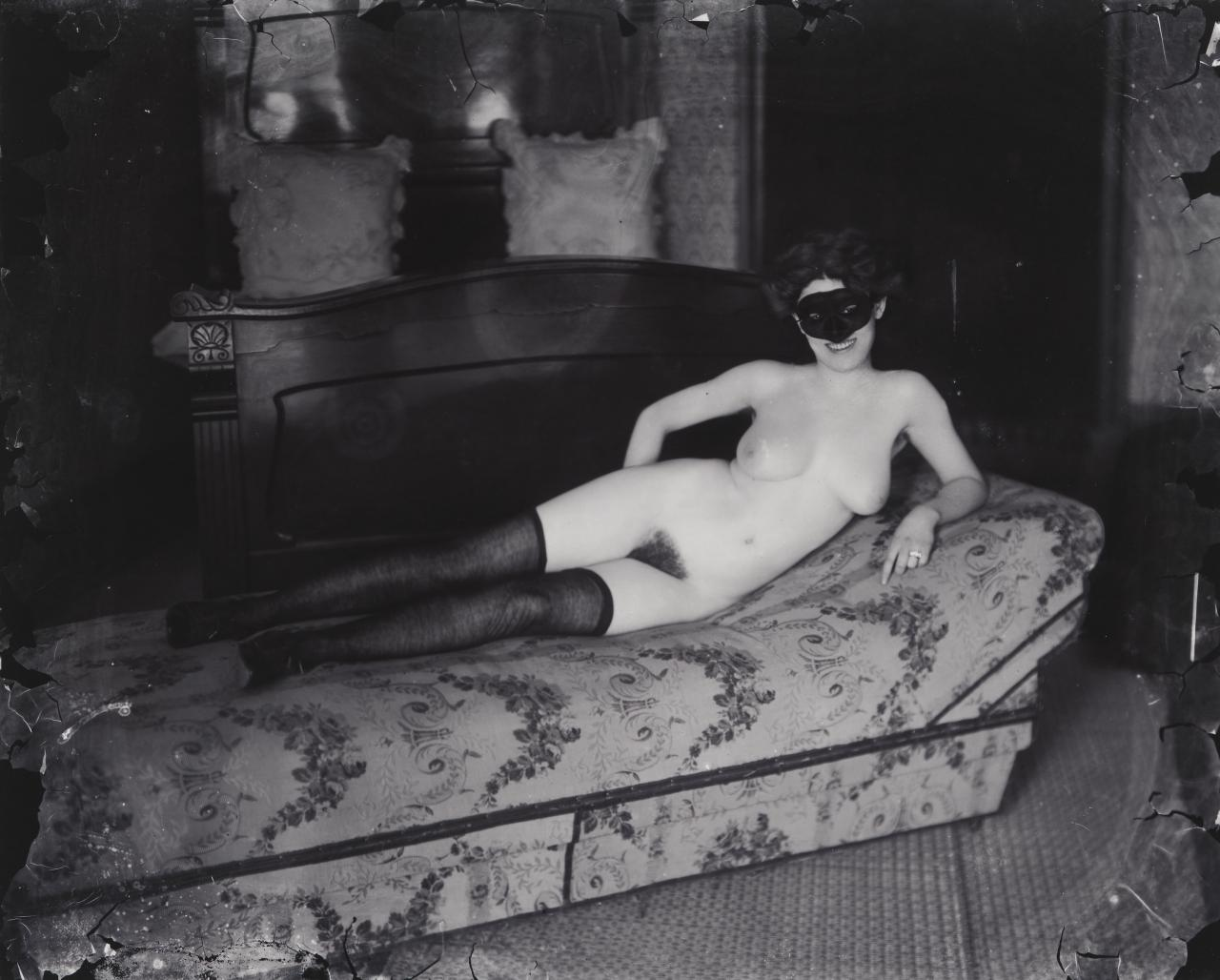 No title (Woman reclining with mask)