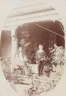 No title (Young girl and boy on verandah), cabinet print